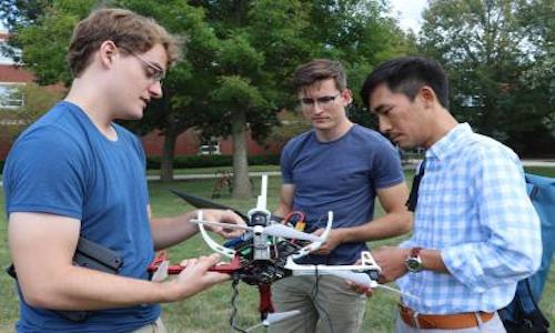 From left, Van Stralen, Ayberk Yaraneri, and Huy Tran testing a drone.